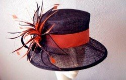 Beautiful black wedding hat with red ribbon
