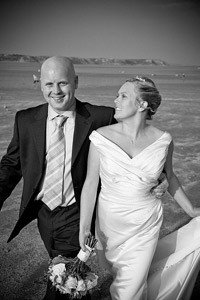 Beautiful black and white wedding photo set on a beach